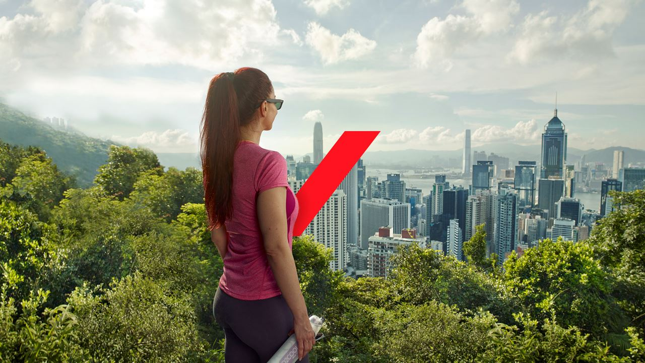 Lady overlooking city with red AXA switch.
