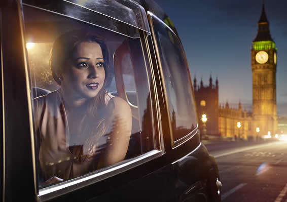 Woman in taxi with Big Ben in the background